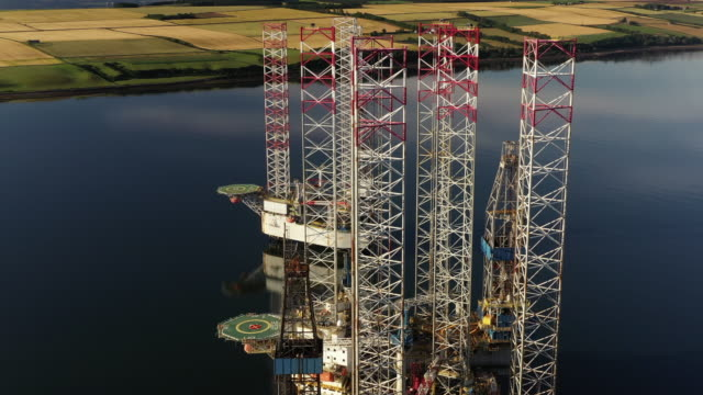 panning aerial shot showing three oil rigs in cromarty firth, scotland, united kingdom - old fashioned stock videos & royalty-free footage