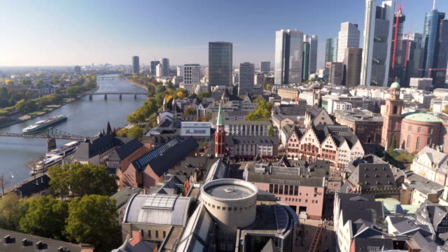 panning aerial view: cityscape of frankfurt in morning when autumn is coming , germany - european culture stock videos & royalty-free footage