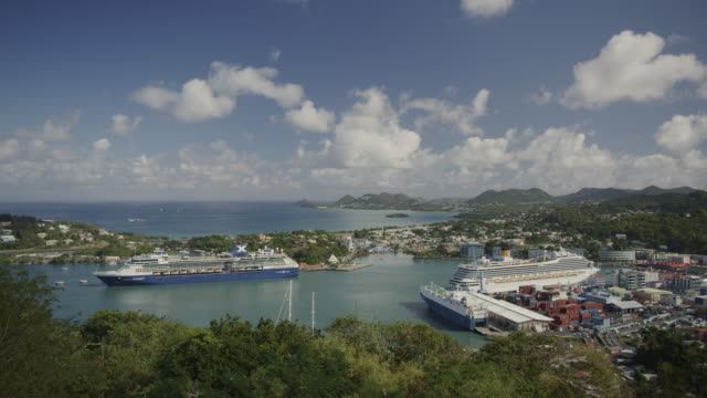 panning aerial view of distant cruise ships at waterfront / castries, - cruise stock videos & royalty-free footage
