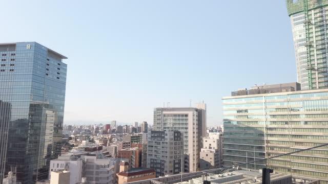 4k panning aerial view of shibuya ward in tokyo , japan . - international landmark stock videos & royalty-free footage