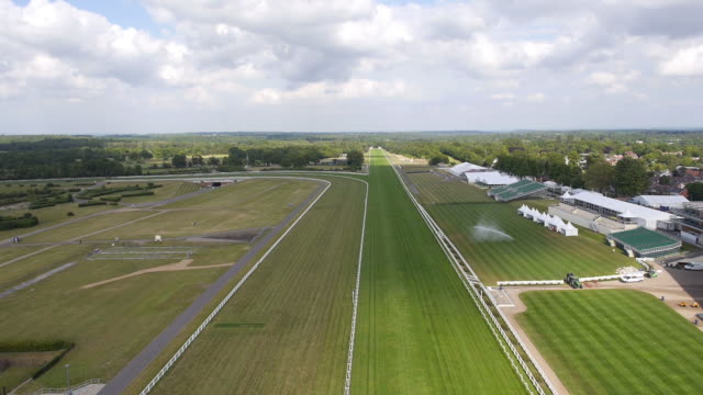 panning aerial view of the new grandstand at ascot racecourse - captured by a licensed uav operator with pfaw - ロイヤルアスコット点の映像素材/bロール
