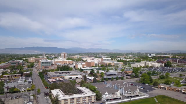 panning aerial view overlooking provo utah - provo stock-videos und b-roll-filmmaterial