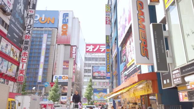 4k panning . akihabara electric town in tokto , japan . - akihabara station stock videos and b-roll footage