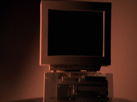 panning around desktop computer with transparent cover - 2003 stock-videos und b-roll-filmmaterial