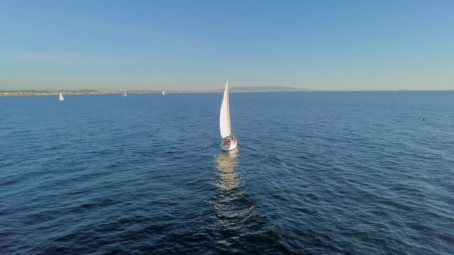panning around yacht on ocean at sunset - sailing stock videos & royalty-free footage
