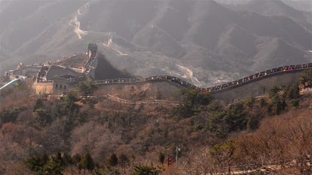 panning: badaling great wall of china belong to peak of mountain - badaling great wall stock videos & royalty-free footage