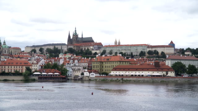 panning: building in prague along vltava river - hradcany castle stock videos and b-roll footage