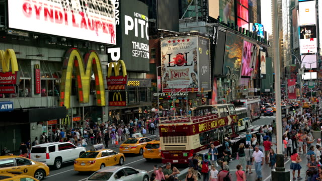 panning camera from mcdonalds to time square - banner sign stock videos and b-roll footage