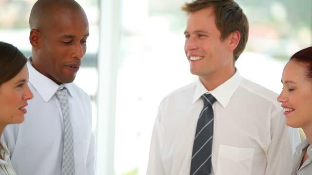 vidéos et rushes de panning camera showing business colleagues having fun - chemise et cravate