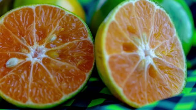 panning camera:fresh orange slice - slice stock videos & royalty-free footage