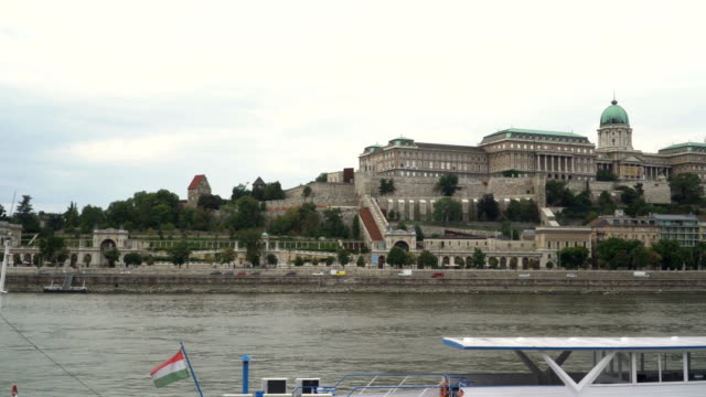 panning: city view around danube river that consisted of royal palace in budapest, hungary - royal palace of buda stock videos & royalty-free footage
