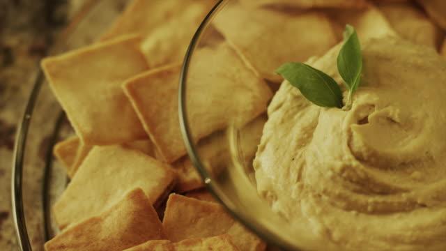 panning close up high angle shot of pita chips and hummus / cedar hills, utah, united states - bowl stock videos & royalty-free footage