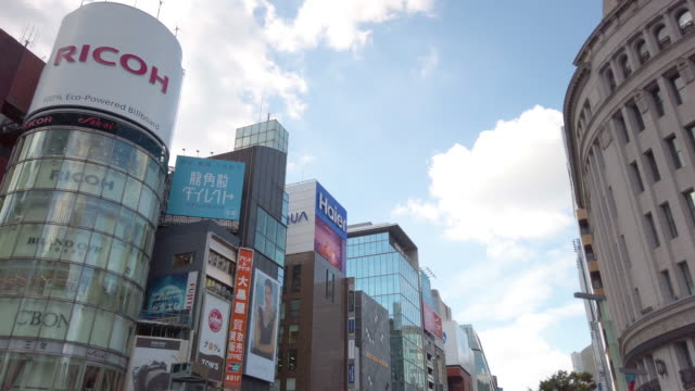4k panning directly below . ginza area in tokyo , japan . - department store stock videos & royalty-free footage