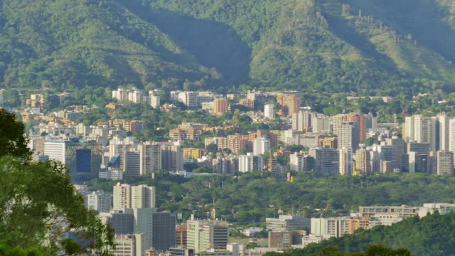 panning dolly shot view of eastern district in caracas city valley - caracas stock videos & royalty-free footage