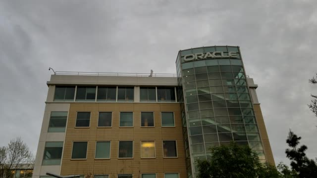 panning down facade at regional headquarters of technology company oracle in dublin california april 9 2018 - oracle corporation stock-videos und b-roll-filmmaterial