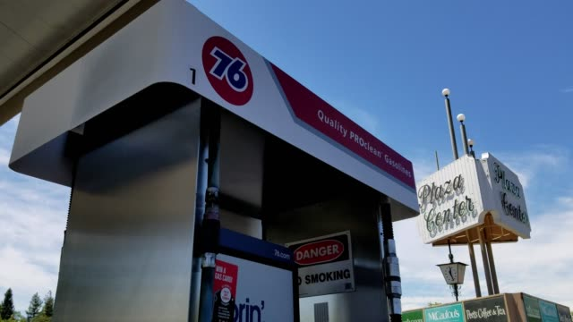 panning down from logo for 76 petroleum company on fuel pump to gas prices at gas station in lafayette california june 18 2018 - conocophillips stock-videos und b-roll-filmmaterial