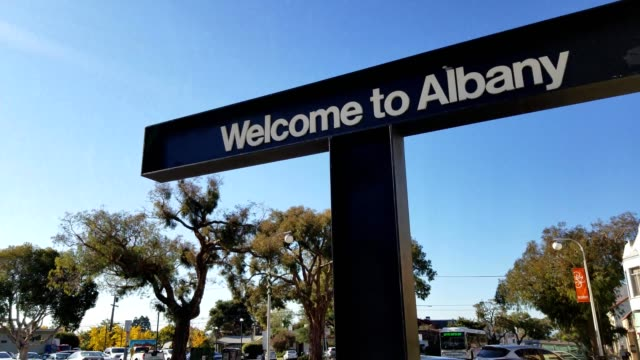 panning down from sign reading welcome to albany to solano avenue in albany california on a sunny day december 7 2018 - december stock videos & royalty-free footage