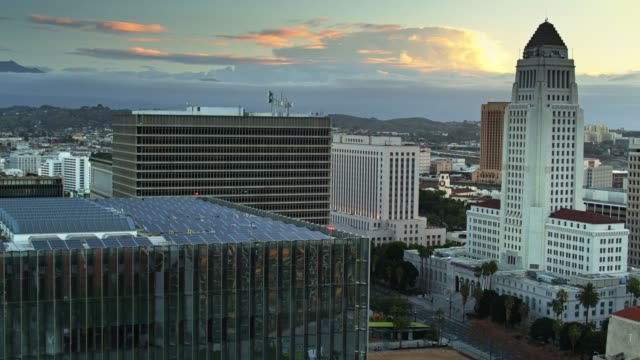 panning drone shot of civic buildings in la at dawn - courthouse stock videos & royalty-free footage