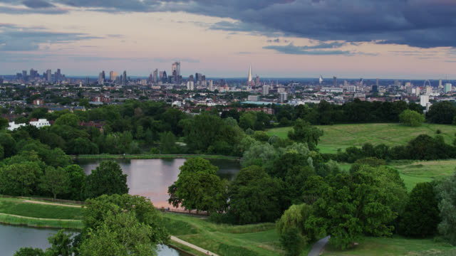 panning drone shot of hampstead heath with london cityscape - parliament hill stock videos & royalty-free footage