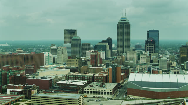 panning drone shot of indianapolis on overcast morning - 40 seconds or greater stock videos & royalty-free footage