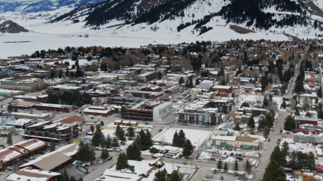 panning drone shot of jackson - jackson hole stock-videos und b-roll-filmmaterial