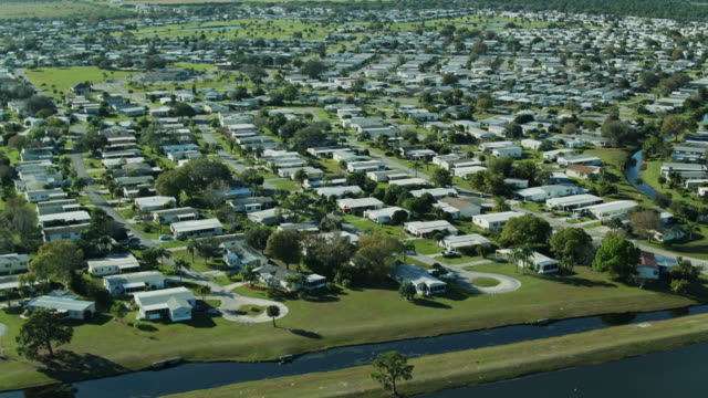 panning drone shot of large manufactured home community - florida us state stock videos & royalty-free footage