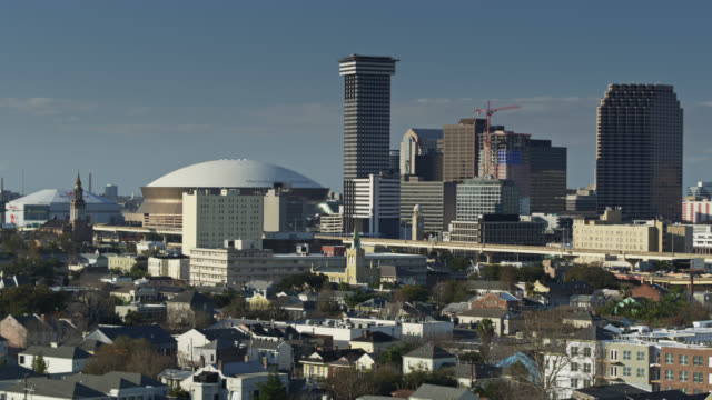 panning drone shot of new orleans skyline including superdome - new orleans stock videos & royalty-free footage