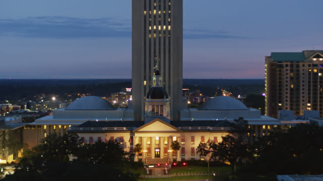 panning drone shot of old florida state capitol at twilight - florida us state stock videos & royalty-free footage