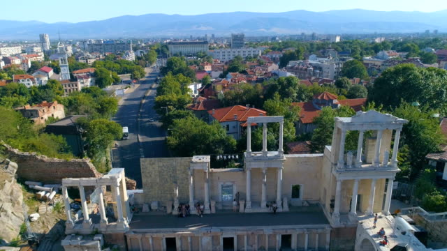 panning drone shot of the ancient roman amphitheater in the old town of plovdiv, bulgaria - moving down video stock e b–roll