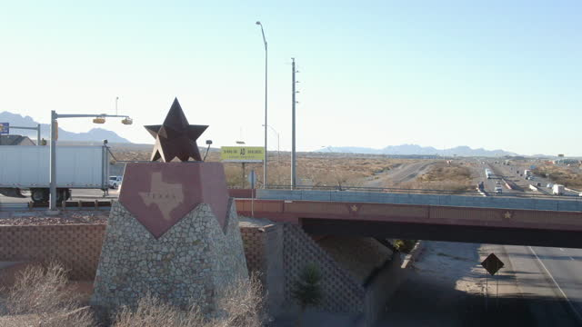 panning drone view of the texas border, state line marker coming from anthony, new mexico entering el paso county - texas stock videos & royalty-free footage