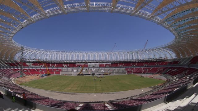 panning fisheye lens shot construction at estadio beirario in porto alegre continues home to the sport club internacional one of brazil's biggest... - alegre stock videos & royalty-free footage