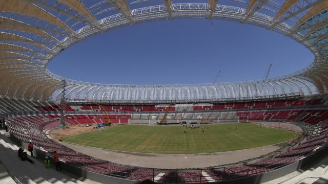 panning fisheye lens shot construction at estadio beirario in porto alegre continues home to the sport club internacional one of brazil's biggest... - porto alegre stock-videos und b-roll-filmmaterial