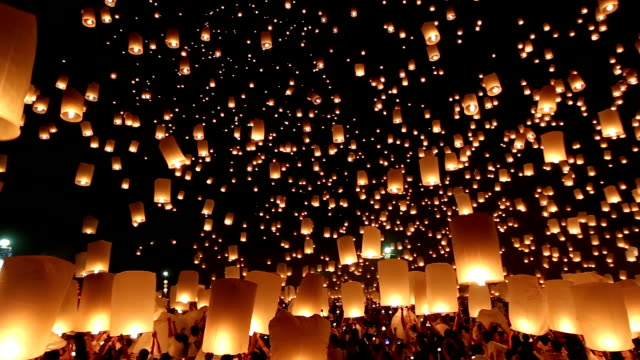 hd panning: flying lantern yeepeng loi kra tong festival in thailand - releasing stock videos & royalty-free footage