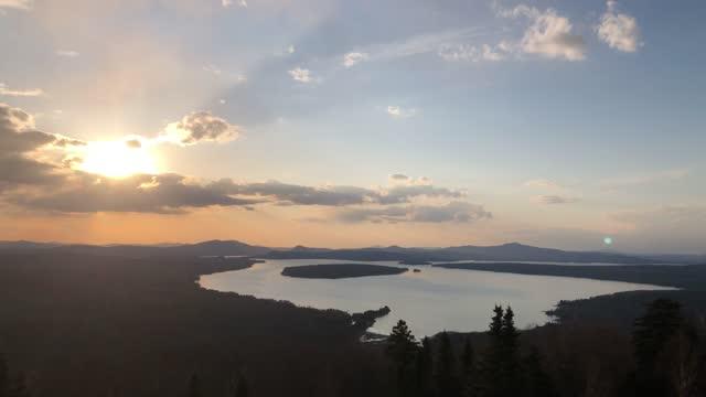 panning footage of lake mooselookmeguntic sunset near rangeley, maine - named wilderness area stock videos & royalty-free footage