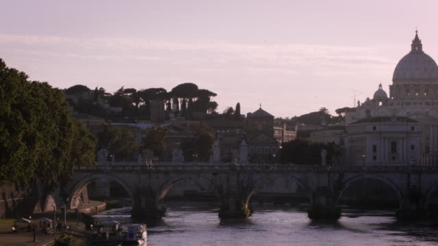 Panning footage of the dome of St. Peter's Basilica from a bridge on the Tiber