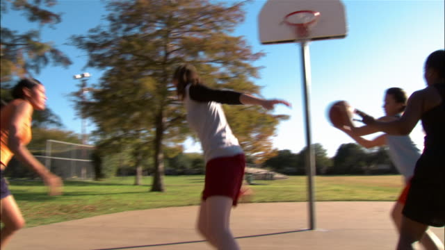 panning four young women playing basketball - 30 seconds or greater stock videos & royalty-free footage