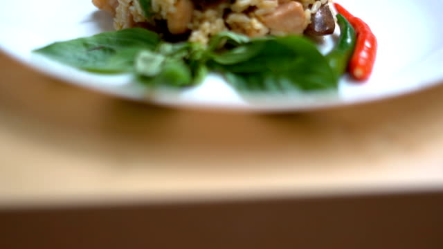 panning fried green curry rice on the white plate. - fried rice stock videos and b-roll footage