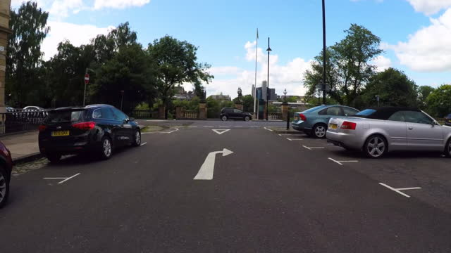 panning from a car the historic victorian apartment homes of downtown glasgow and approaching a lush green public park - stationary stock videos & royalty-free footage
