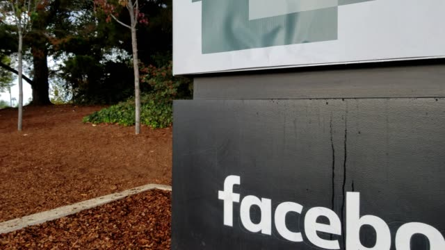 Panning from text reading Facebook to wooded area at headquarters of social media company Facebook in the Silicon Valley Menlo Park California...