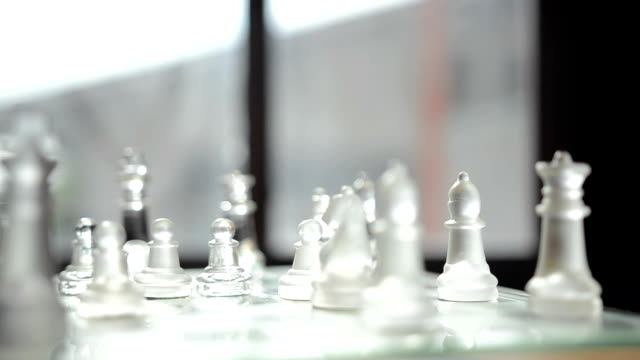 panning: glass chess is behind on window - group of objects stock videos & royalty-free footage