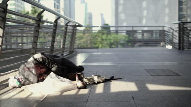 panning: homeless sleeping on the footpath. - beggar stock videos & royalty-free footage