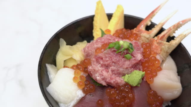 panning in kaisen donburi or sashimi rice bowl on white table - tuna seafood stock videos & royalty-free footage