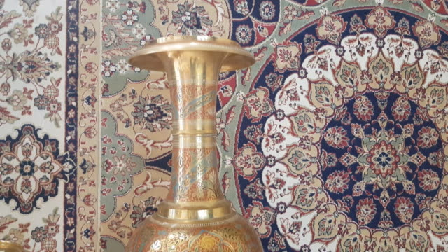 panning india brass pot and carpet - jewellery stock videos & royalty-free footage