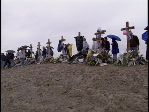 panning left shot of crosses and flowers of columbine shooting victims - colorado stock videos & royalty-free footage