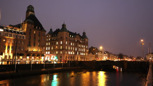 Panning Malmo Cityscape downtown at night twilight in Sweden
