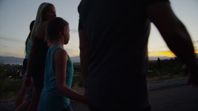 panning medium shot of family walking along road / cedar hills, utah, united states - five people stock videos & royalty-free footage