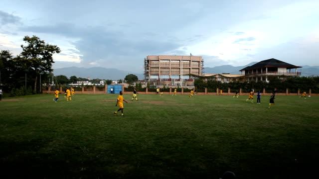 panning ls men playing soccer, harare, zimbabwe - zimbabwe stock videos and b-roll footage