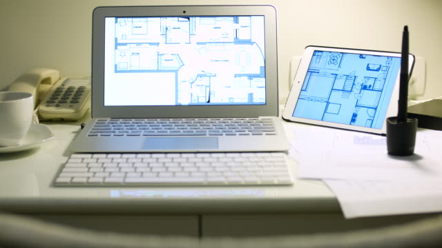 Panning movement of blueprint and Laptop for work, 4K(UHD)