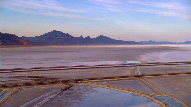 panning over evaporation pools at the bonneville salt flats / utah - salt flat stock videos & royalty-free footage