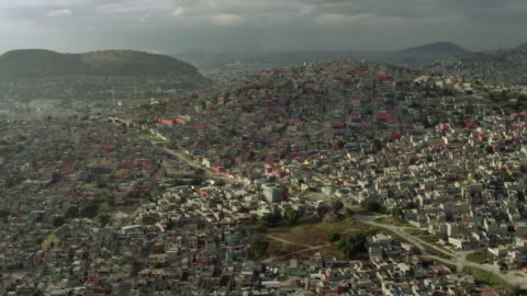 panning over mexico city suburb - population explosion stock videos & royalty-free footage
